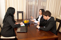 Conversation at job interview. Three business people having conversation at job interview Royalty Free Stock Image