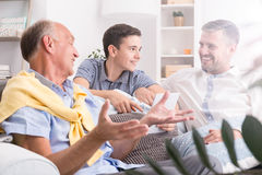 Conversation between male generations Royalty Free Stock Image