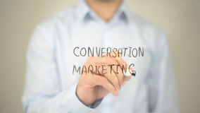 Conversation Marketing, Man writing on transparent screen royalty free stock photo