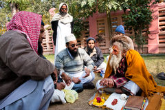 Conversation of the Muslim people & one hindu man about religion Royalty Free Stock Photography