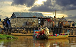 Conversation of neighbours on boats. It is photographed on lake Tonle Sap, approximately in 40 kilometers from city Siem Reap. Cambodia Stock Image