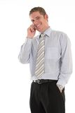 Conversation not too bad. Businessman talking on his cellphone and smiling Royalty Free Stock Photos