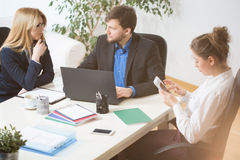 Conversation in the office Royalty Free Stock Photos