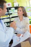 Conversation with the pharmacist. Pharmacist stock image