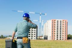 Conversation on residential construction site Stock Image