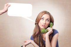 Conversation téléphonique ennuyeuse image stock
