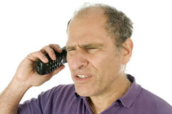 Conversation téléphonique fâchée de renversement émotif d'homme Photographie stock libre de droits