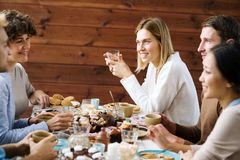 Conversation by table Royalty Free Stock Image