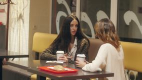 Conversation between two girls. Intensive conversation between two girls stock video