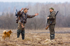 Conversation between two hunters. Two hunters talk on the field Stock Photography