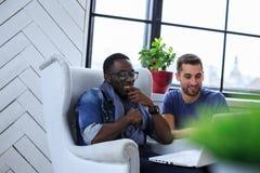 Conversation of two international students. Studio shot Royalty Free Stock Photos