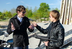 Conversation between two thugs. In an abandoned construction site Royalty Free Stock Photography