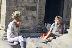 Conversation of two wise yogis in Pashupatinath temple, Nepal, Kathmandu. December 2017, editorial Royalty Free Stock Images