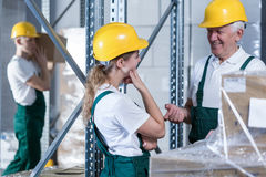 Conversation in warehouse Stock Photography