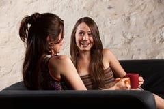 Conversazione graziosa delle donne Fotografia Stock