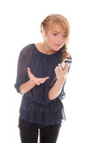 Conversazione impressionabile dell'adolescente sul telefono delle cellule Immagini Stock