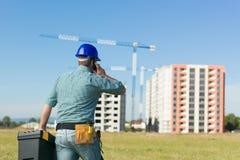 Conversazione sul sito dell'edilizia residenziale Immagine Stock