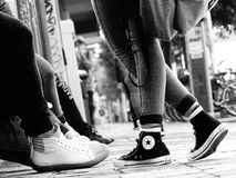 Converse All Star. Group of boys and girls in the city , first floor on the shoes that identify the current fashion in 2016 Stock Image