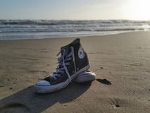 Converse black and white on the beach Royalty Free Stock Photography