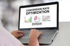 Conversion rate optimization concept on a laptop. Woman using a laptop with conversion rate optimization concept on the screen stock photos