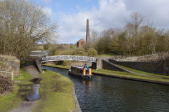 A Converted Barge cruising on the canal Royalty Free Stock Photography