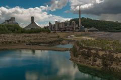 Converted industrial area into recreational zone in Maastricht. Old marl quarry with in the background the former ENCI factory in Maastricht which is converted royalty free stock photography