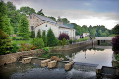 Converted Mill. Historic old mill on a river, converted into a restaurant Stock Photography