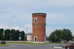 Converted water tower of red brick. Belarus Royalty Free Stock Photos