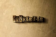 CONVERTER - close-up of grungy vintage typeset word on metal backdrop Stock Photos