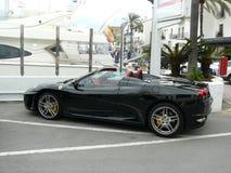 Convertible black Ferrari F430 in Puerto Banus royalty free stock photos