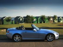Convertible Car. Honda S2000 parked on a lonely seafront road in summer Royalty Free Stock Photos