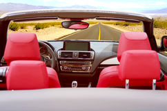 Convertible car on the road Stock Photography