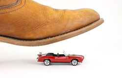 Convertible car about to be stepped on Royalty Free Stock Image