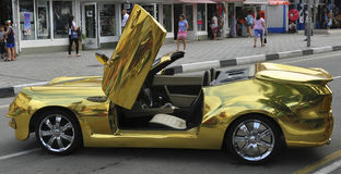 Convertible golden. Retro sports car golden color on display Stock Photos