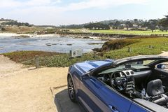 Convertible on 17 mile drive in california. Convertible on 17 mile drive, california Royalty Free Stock Images