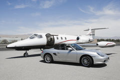 Convertible And Private Jet Royalty Free Stock Photography