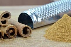Converting  cinnamon stick to powder Stock Image