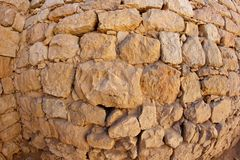 Convex ancient stone wall texture Royalty Free Stock Photography