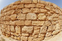 Convex ancient stone wall texture. Shot with fish-eye lens Royalty Free Stock Photo