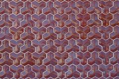 Convex burgundy tiles of regular geometric shape with curved facets as background or backdrop.  royalty free stock photography