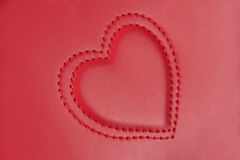 Convex embroidery in shape of two hearts on pink leather, side v Stock Photography
