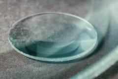 A convex lens. Optical convex lens, glass lens close up stock images