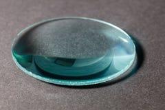 A convex lens. Optical convex lens, glass lens close up royalty free stock photography