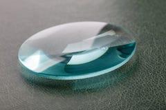 A convex lens. Optical convex lens, glass lens close up royalty free stock photos