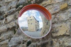 Convex mirror. Convex mirror reflecting a building Stock Image