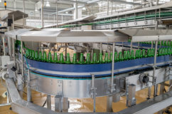 Conveyer belt with beer bottles in a brewery Royalty Free Stock Photos