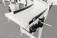 Conveyer belt. Industrial conveyer belt close up stock image