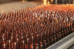 Conveyer line with many beer bottles Royalty Free Stock Images