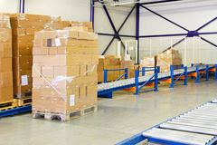 Conveyer ramp. For box transport in warehouse stock photo
