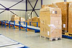 Conveyer transport ramp. Conveyer ramp for box transport in warehouse stock image